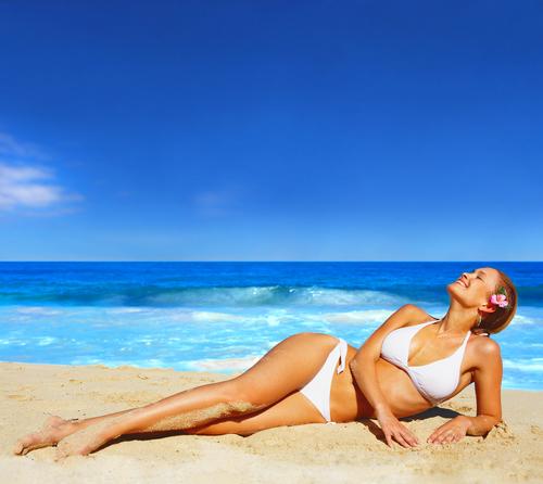 woman reclining on beach-shutterstock_2820944